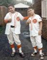 Acting cocky with his brother Mike after a victorious Little League baseball game  (1967)